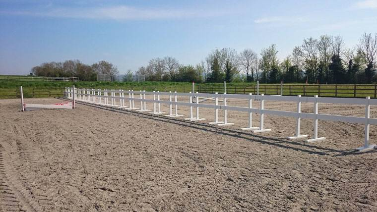 4ft tall 2-rail portable fence used in horse arena