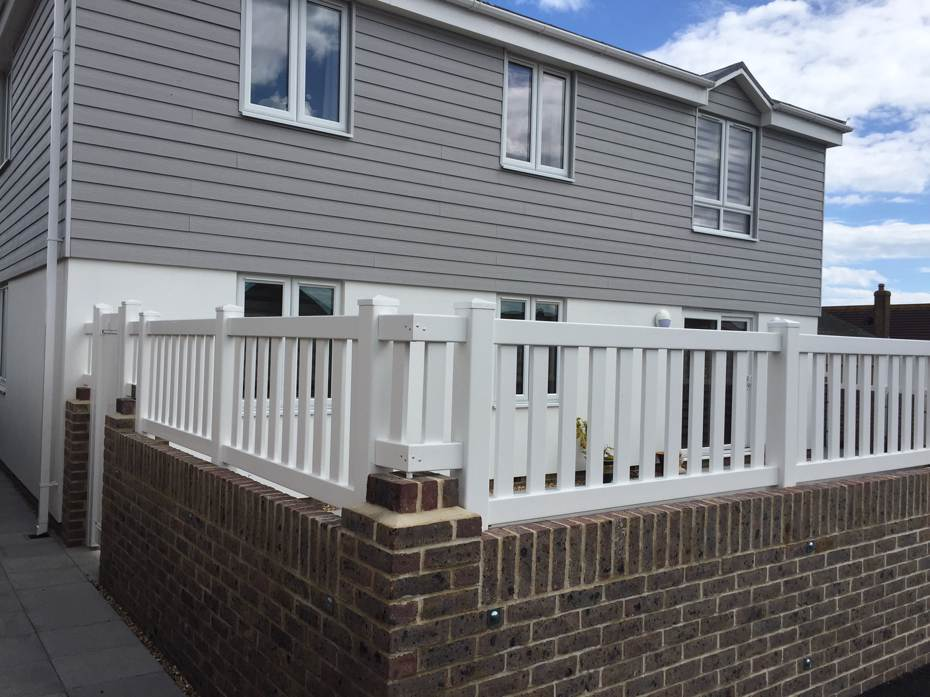 Wall mounted closed top picket fence with 3 inch wide pickets