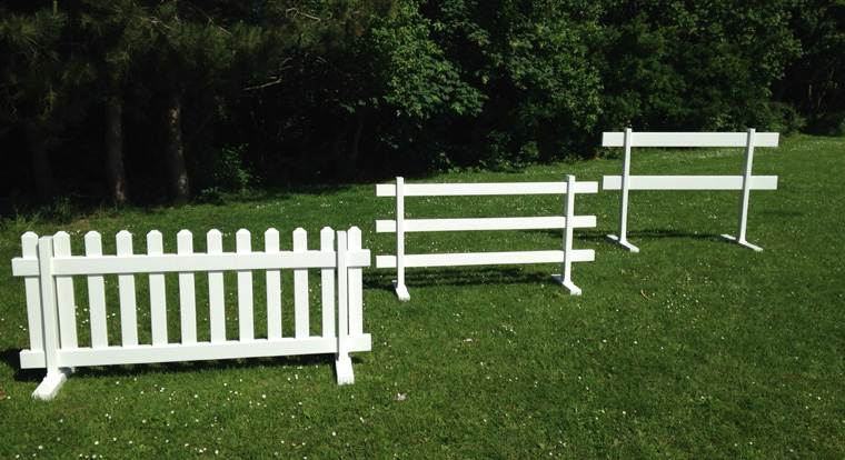 From left to right: temporary picket fence, temporary 3-rail fence, temporary 2-rail fence.